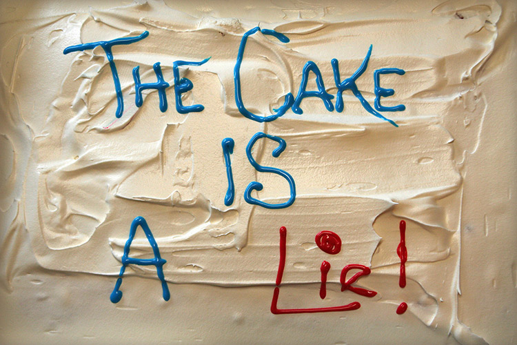 Ruined cake with the phrase THIS CAKE IS A LIE!