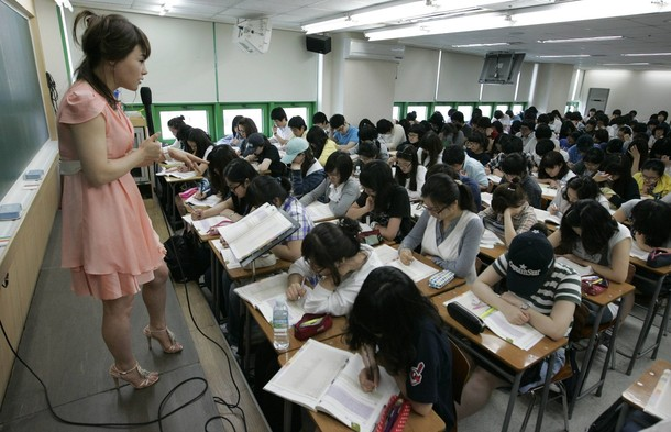 teacher preps a room full of students in south korea cram school