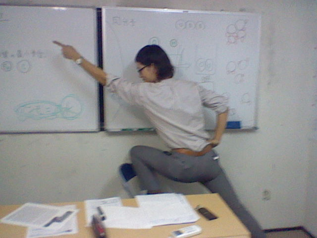 sexy juku teacher pointing man with white board