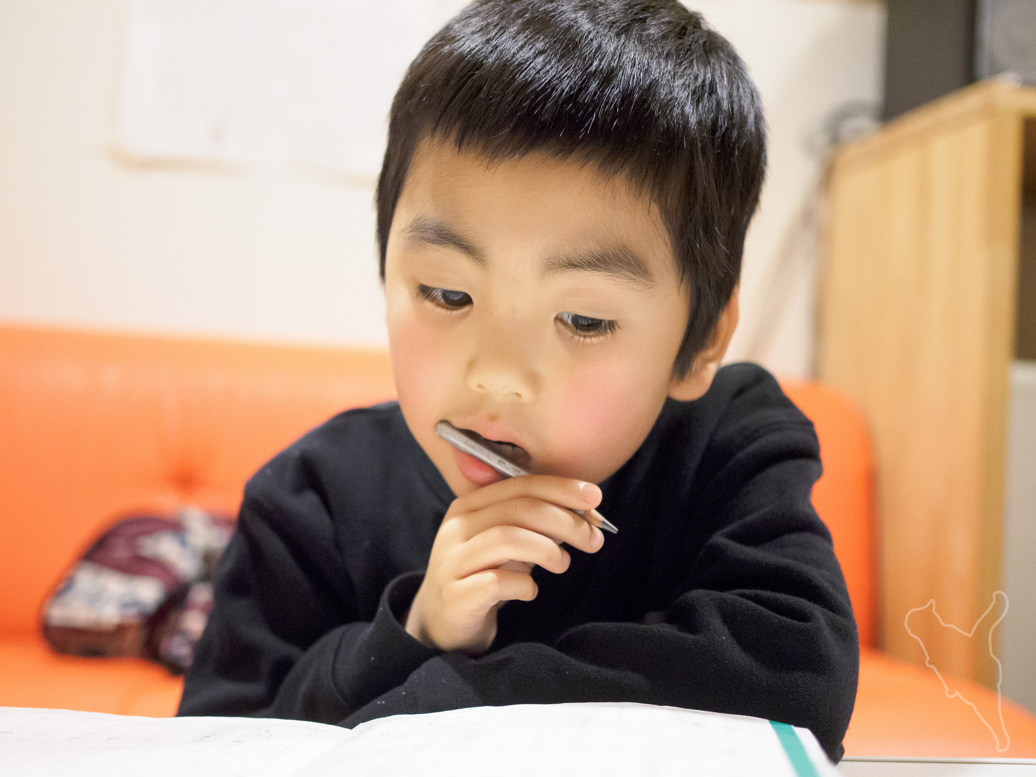 a little japanese boy studying