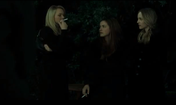 three girls dressed in black smoking definitely witches