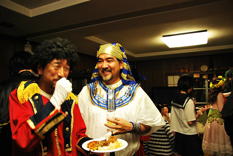 costume dinner with asian men wearing egyptian costumes