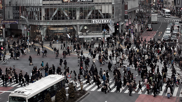 busy shibuya crossing in tokyo viewed from above