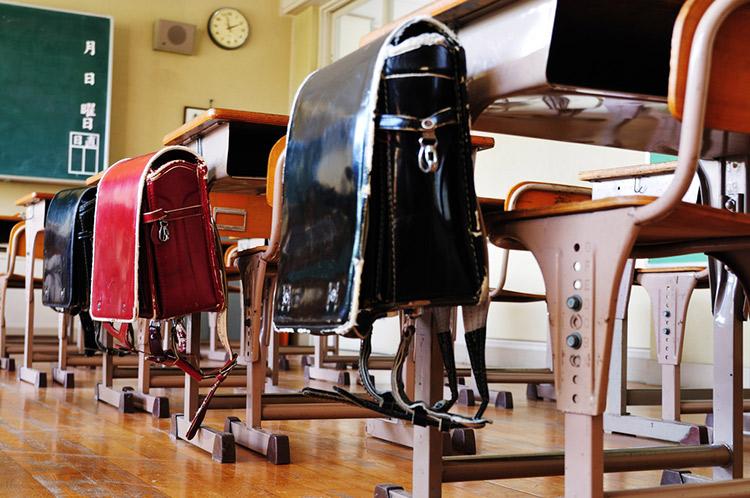 Japanese backpacks hanging on desks