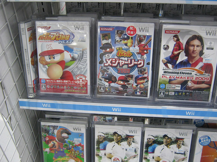 A variety of Japanese Wii games on a shelf