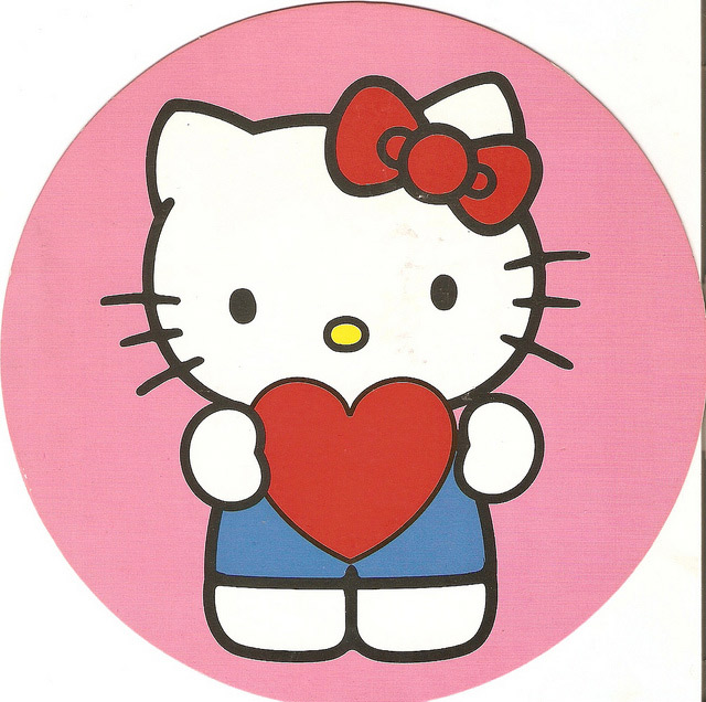 hello kitty holding a heart
