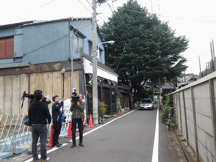 camera crew on side street