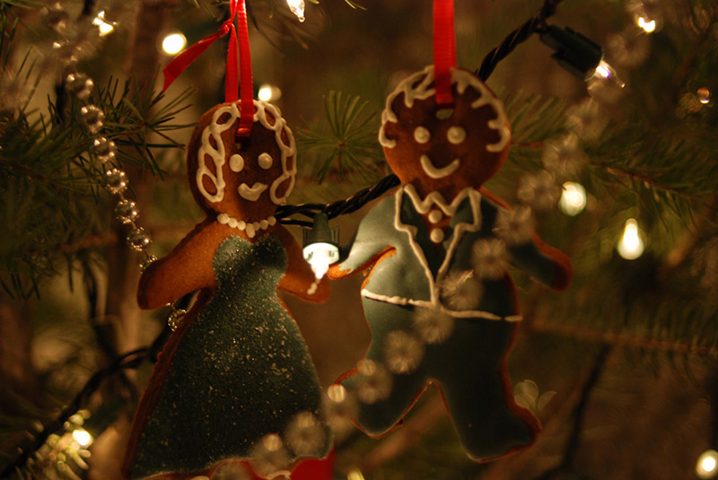 gingerbread cookies hanging from christmas tree