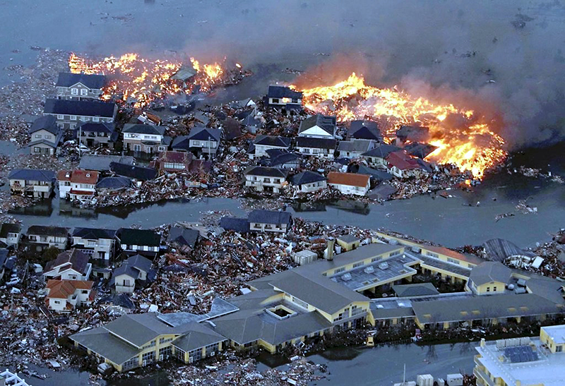 Houses in a flood, on fire