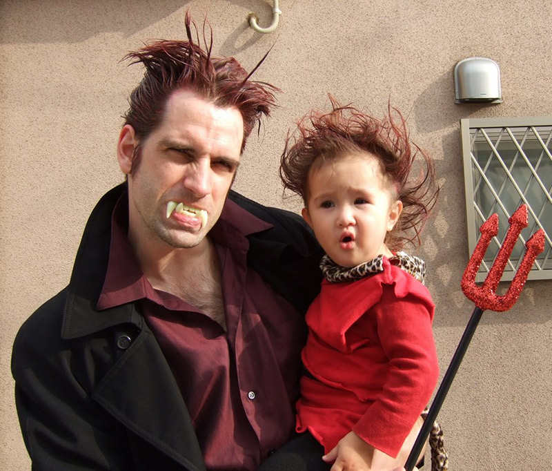 man and baby in costume