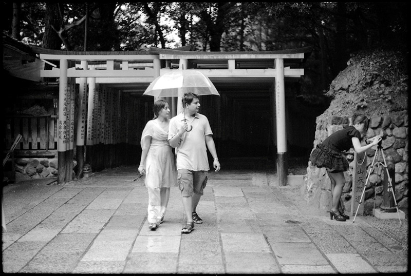 couple walking together holding an umbrella