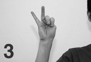 japanese counting gesture three