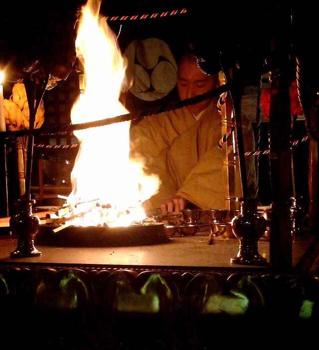 monks fire night scene