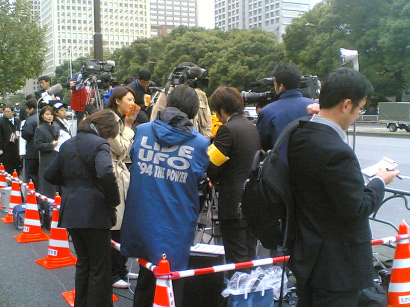 Japanese reporters in a press gang