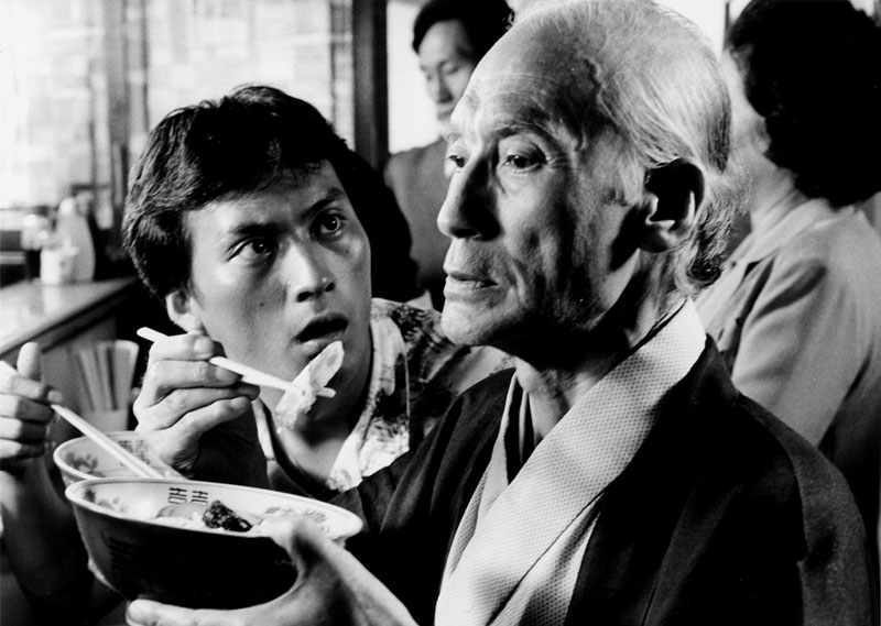 still from the movie tampopo old man takes a bite
