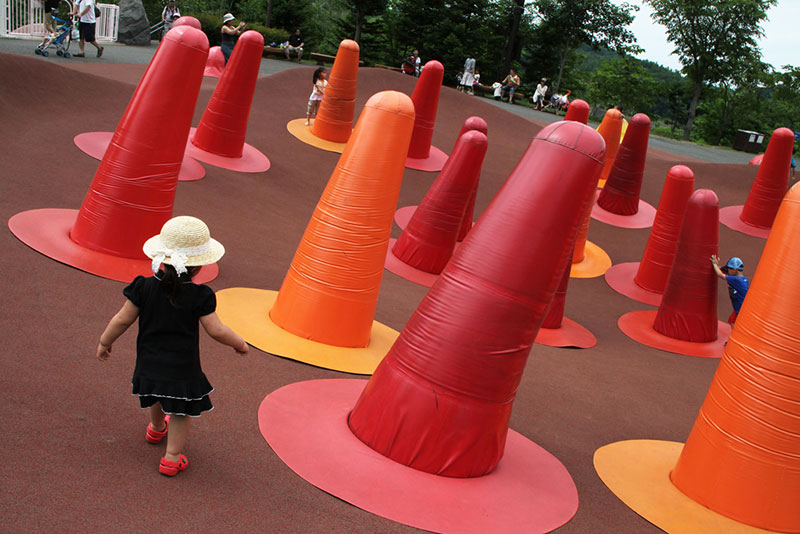 small japanese child navigating red cones