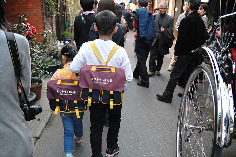 japanese boy leading his brother to from school