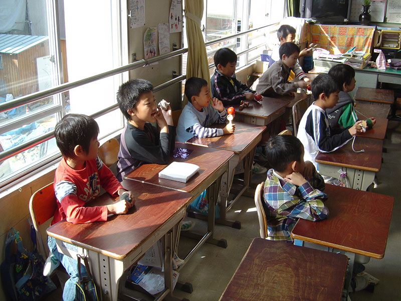 japanese students six boys in an elementary school classroom