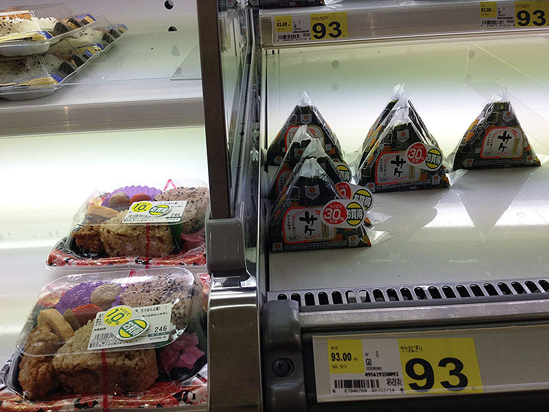 Onigiri in a display case priced at 93 yen