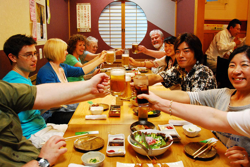 People drinking beer in a Japanese restaurant