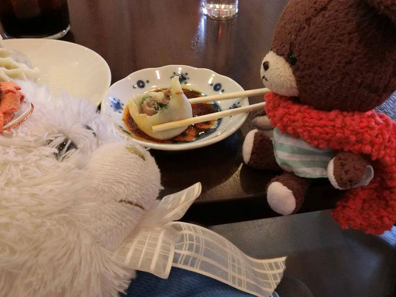 stuffed animals eating japanese food