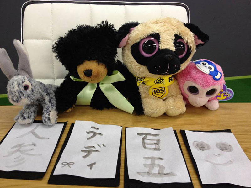 stuffed animals doing shodo