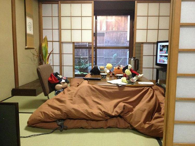 stuffed animal in a kotatsu