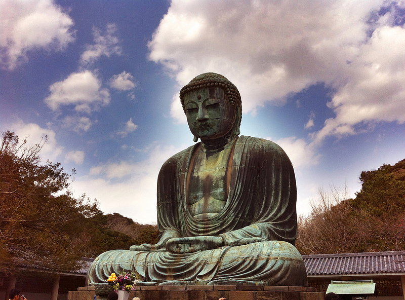 buddha statue in rock garden