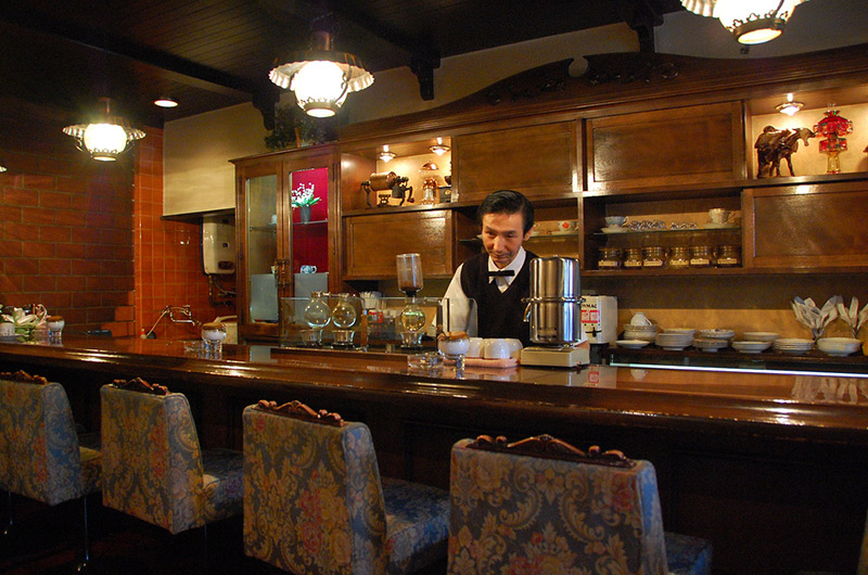 man behind counter at Japanese kissaten