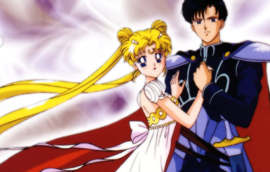 mamoru holding sailor moon to his chest wearing armor