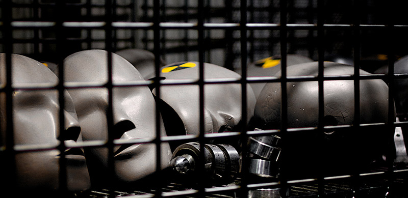 Heads of crash test dummies inside a container