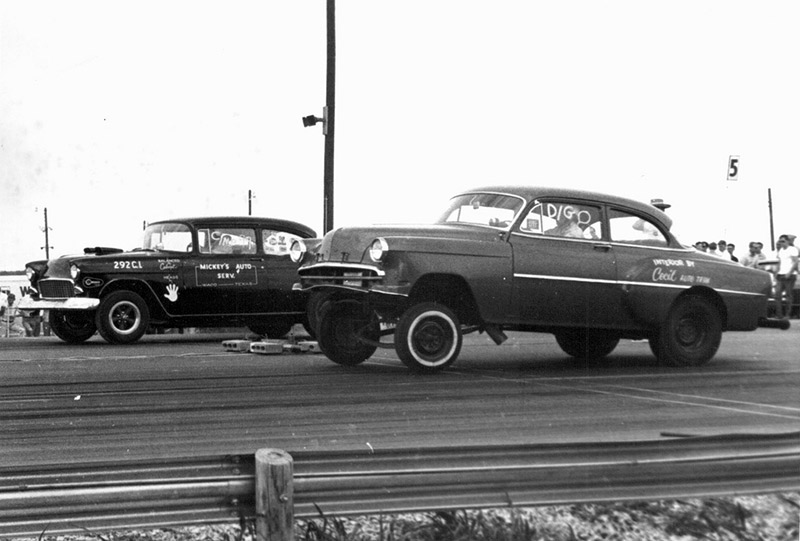 Two cars modified for drag racing in the sixties
