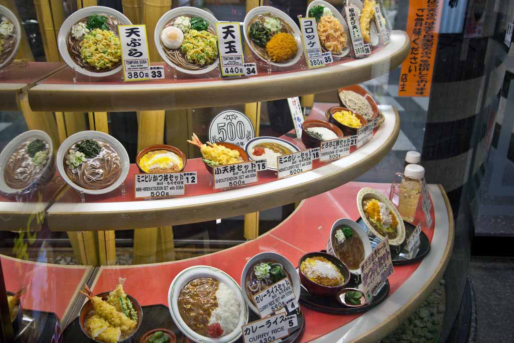 display case of plastic food dishes