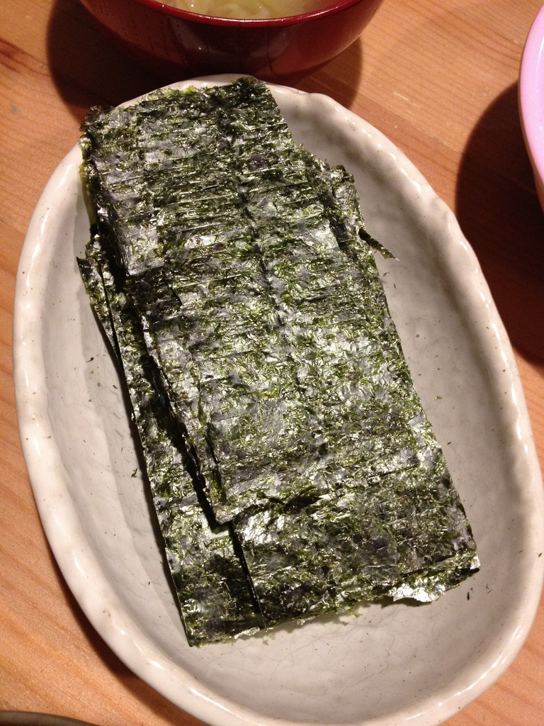 sheets of nori on a white plate