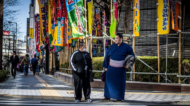 two fat men sumo walking in Japan