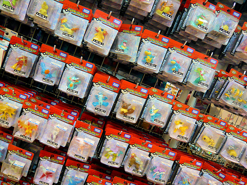 pokemon toys hanging on pegs