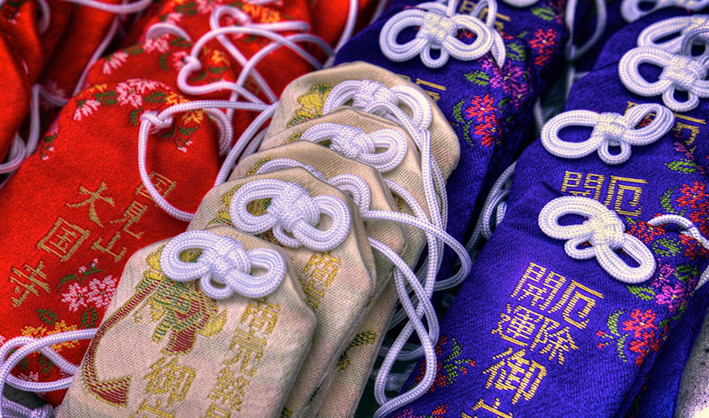 red blue and white omamori charms