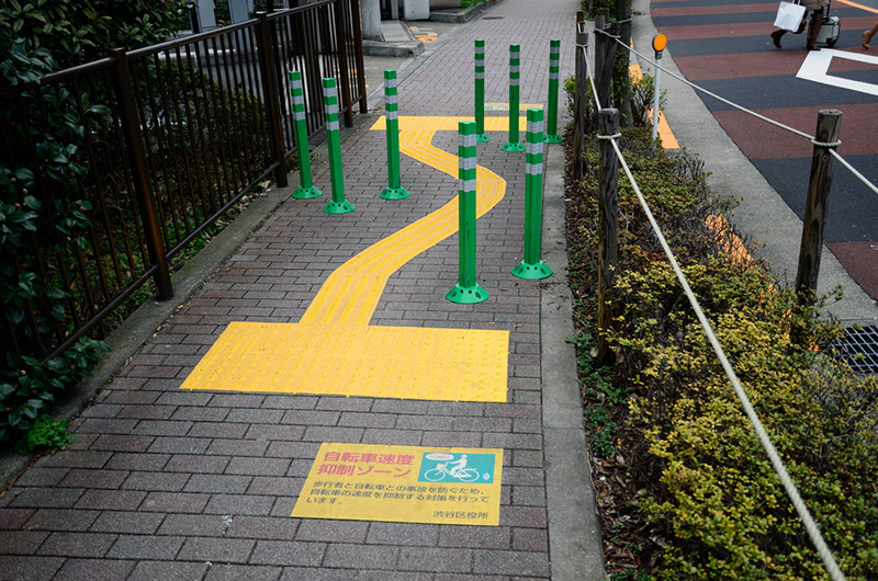 obstacles on bike path with markers for the disabled
