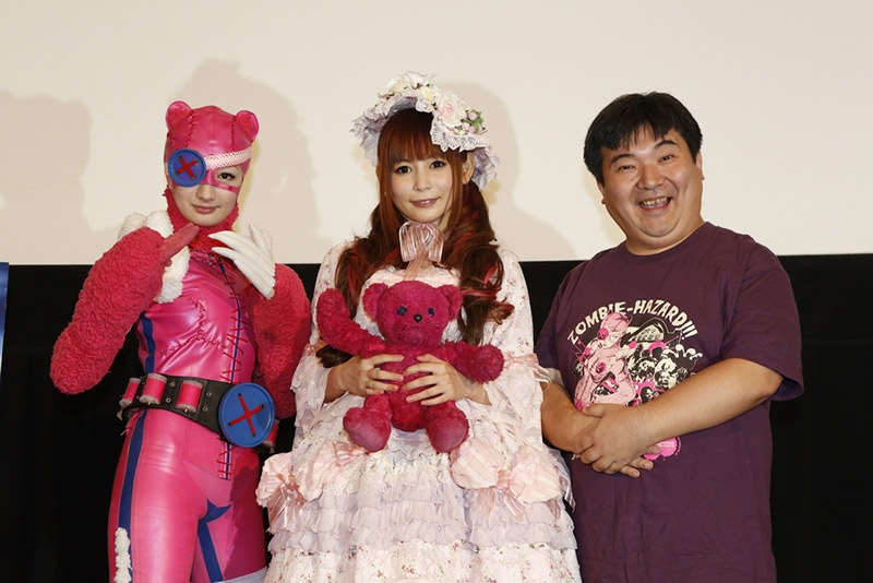 Noboru Iguchi posing with cosplayers