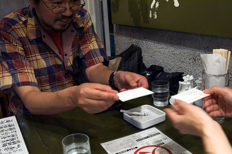 two men exchanging japanese business cards