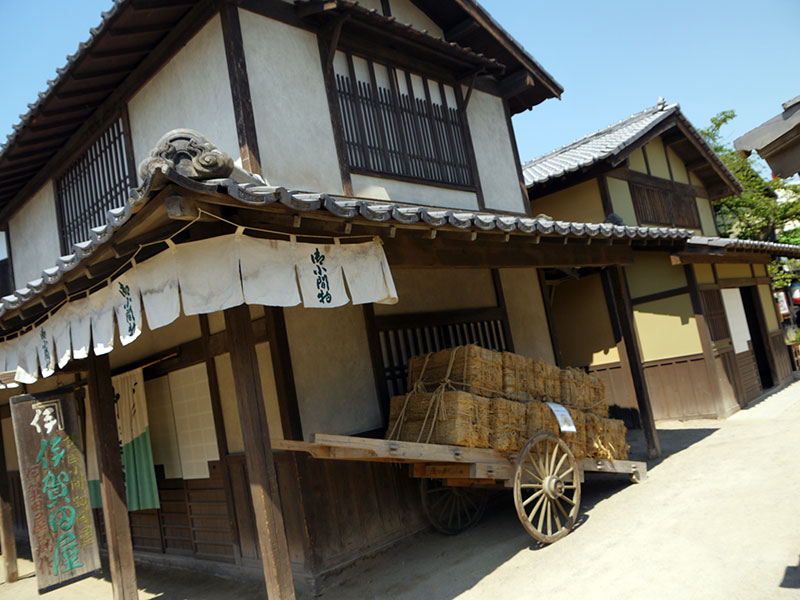japanese building with hay cart outside