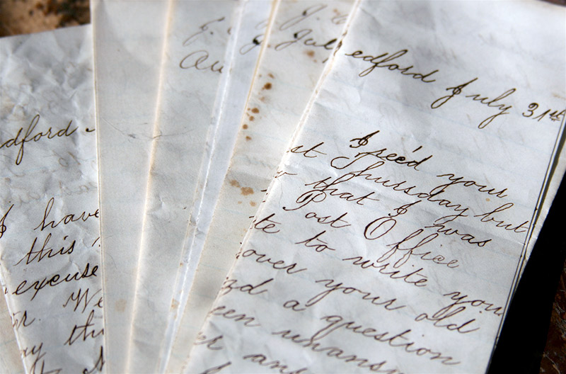 A pile of weathered handwritten letters