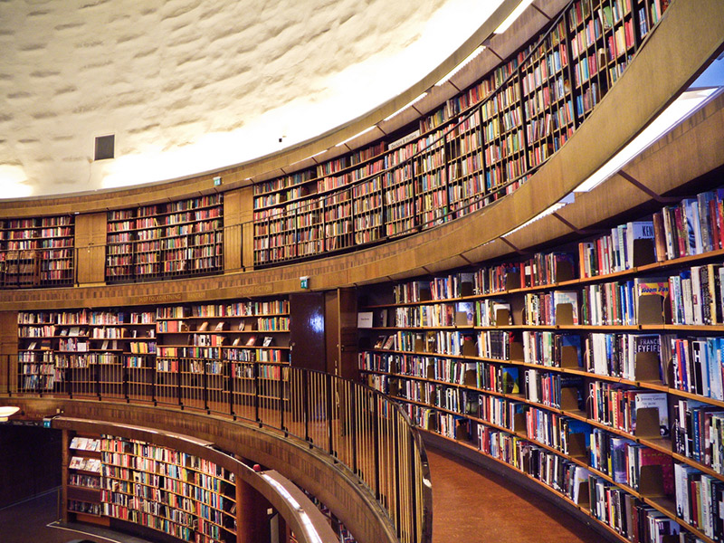 Two floors of books and bookshelves at a library