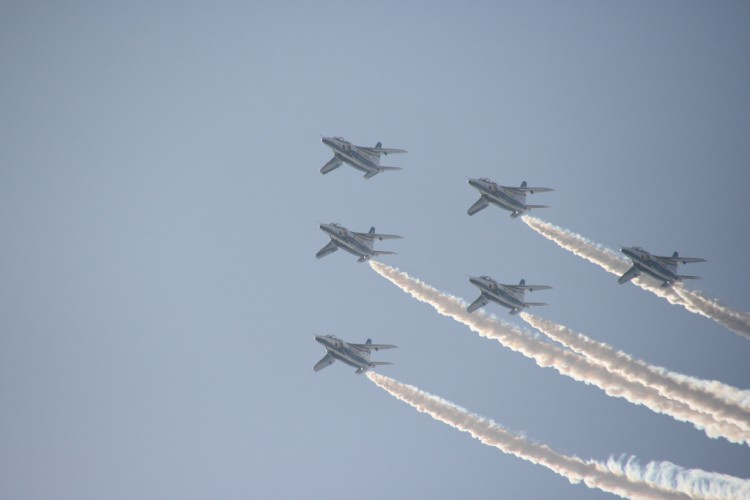 T-4 jets of JASDF Blue Impulse flying overhead