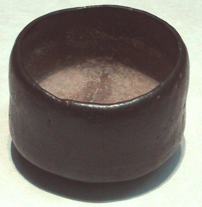 black raku japanese ancient pottery tea bowl