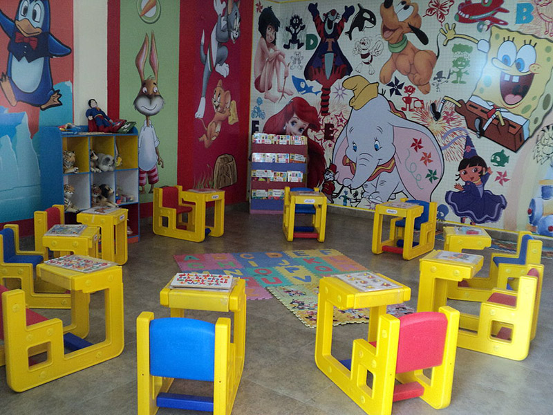 Tables and rubber mats for kindergarteners