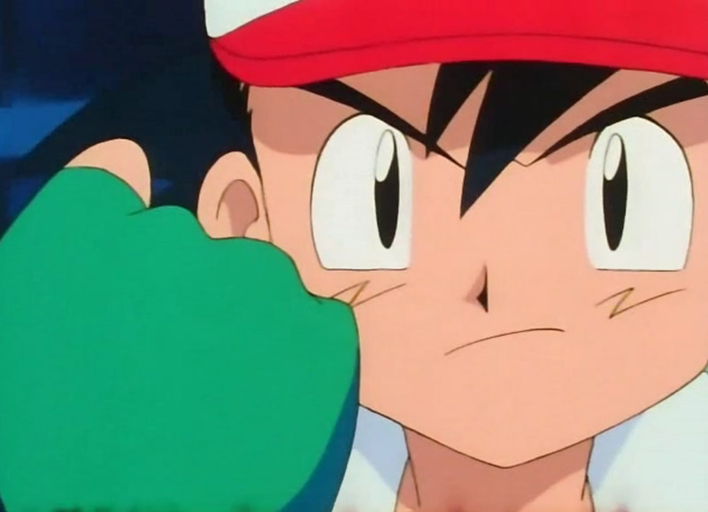 Ash from Pokemon with his fist in front of his face