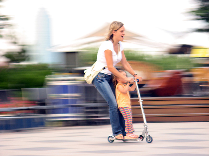 mother and daughter riding a scooter