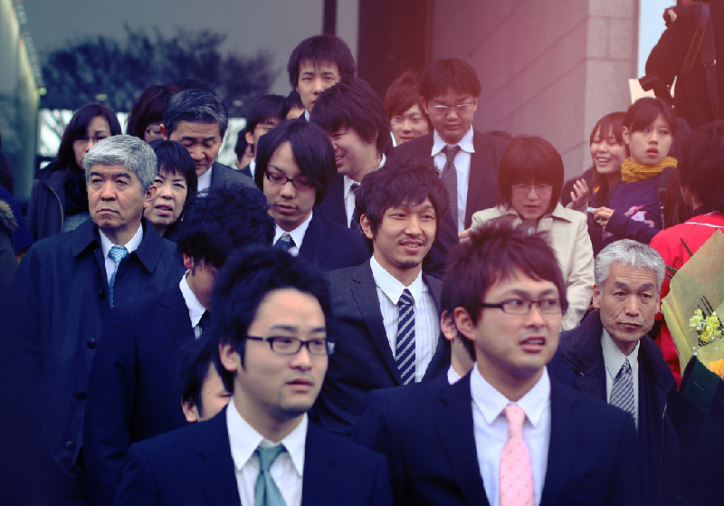 crowd of Japanese businessmen and women