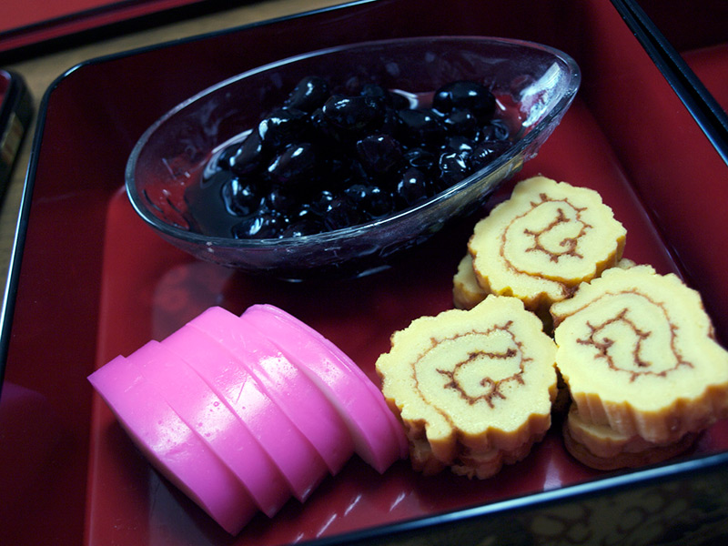 kamaboko on tray with berries yellow orange and pink